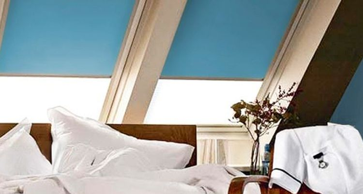 light-blue-velux-blind-bedroom