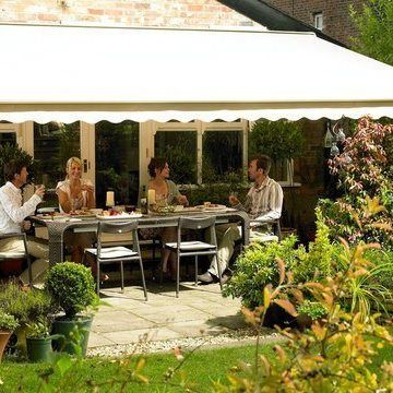 Plain Cream Awning with scalloped hem shading a group of people eating on the patio