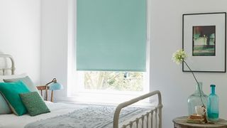 Duck egg blue Blackout roller blind in Burma Eau De Nil fabric in bedroom