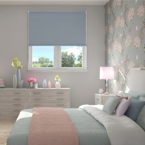 Plain Acacia Blue roller blind hung in bedroom