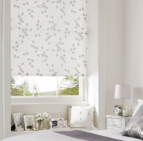 Patterned Seedhead White roller blind hung in bedroom