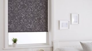 Grey damask-pattern Dulcie Anthracite roller blind hung in bedroom