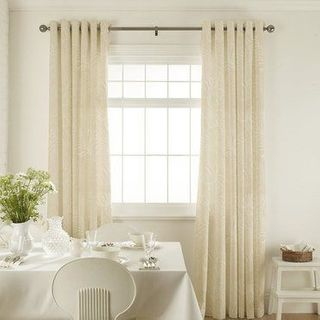 Broadleigh Cotton Curtains in dining room with white furniture