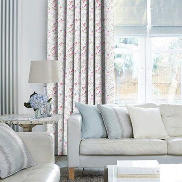 Birdsong Summer Curtains in living room with light grey sofa