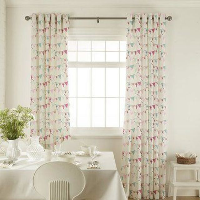 Bunting Chintz Curtains in dining room with white furniture