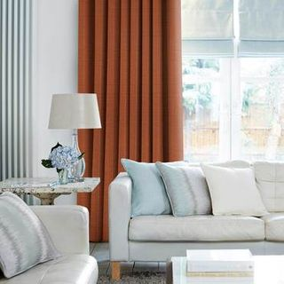 Clarence Terracotta Curtains in living room with light grey sofa