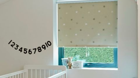 Patterned Twinke Stars Beige roller blind hung in nursery