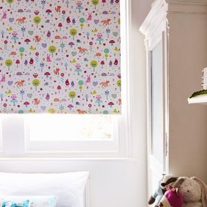 Forest-patterned Woodland Pink roller blind hung in child's room
