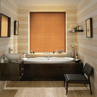 Aluwood Cherry Venetian blinds in a cosy bathroom