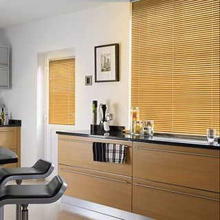 Light wood Aluwood Sugar Maple Venetian blinds in a kitchen