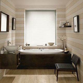 Light Portfolio Cream Venetian blinds in a cosy bathroom