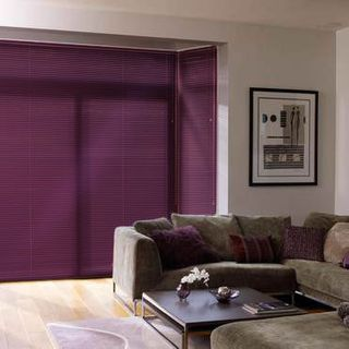 Dark Portfolio Damson Venetian blind hung in a living room