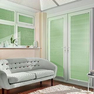 Green Portfolio Pistachio Venetian blinds hanging in patio doors