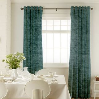 Lyon Teal Curtains in dining room with white furniture
