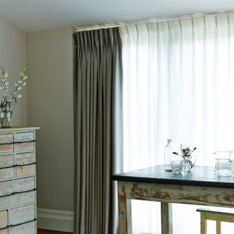 Dining room setting with large window dressed with Opulence Dove grey curtains