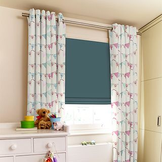 Bunting Chintz Curtains paired with green roman blinds in children's bedroom