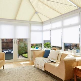 Pleated roof blind Montoya Cream with Acacia White roller side blind Conservatory