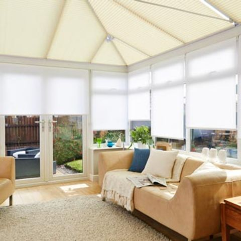Conservatory with Pleated roof blind in Montoya Cream and Roller Side Blind in Acacia White