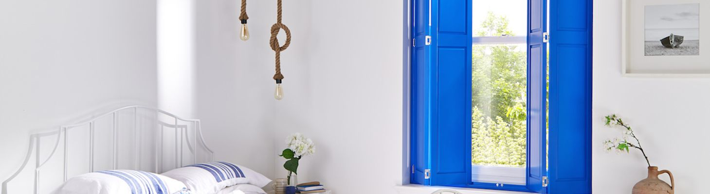 Solid Blue Shutters in a Bedroom