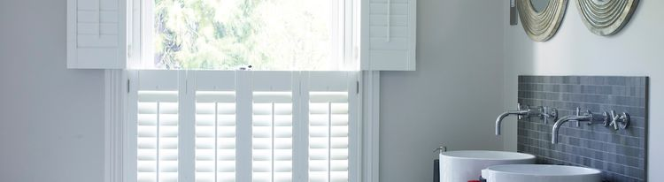 Tier on Tier White Shutters in a Bathroom