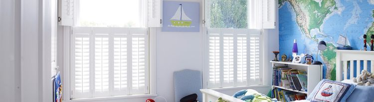 Tier on Tier White Shutters in a Bedroom