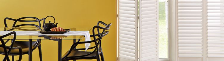 Tracked White Shutters in a Kitchen