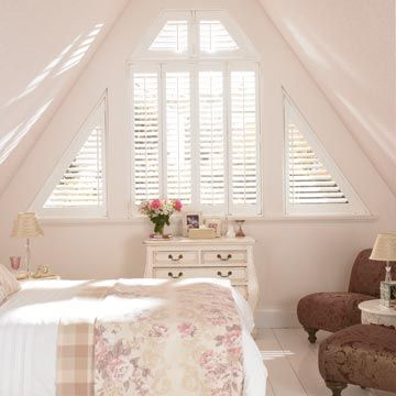 White shaped shutters in a roof conversion window - Silk White Warwick shutters