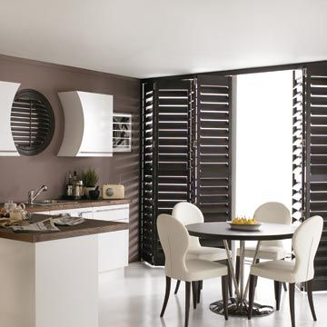 Shaped and Tracked Brown Warwick Shutters