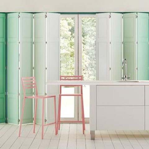 Soild Tracked Shutters painted in different Custom Colour Greens creating an ombre effect