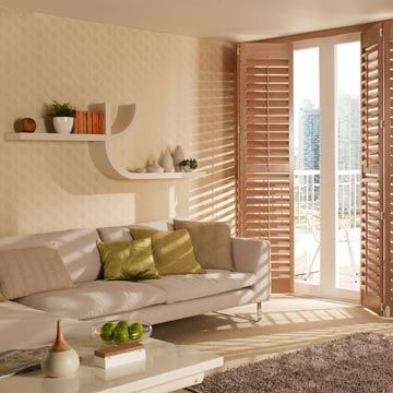 Full height Richmond Shutters in taupe