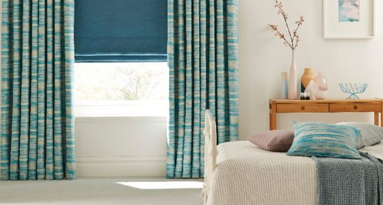 Turqouise-curtains-and-roman-blind-bedroom -