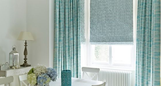 Riviera Turquoise curtains and Daze Peacock Roman blinds -