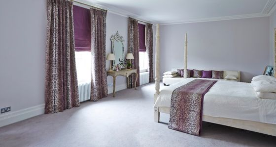 Purple curtains and roman blinds bedroom -
