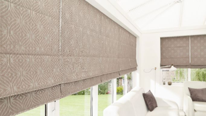 Grey Roman blind with thermal lining conservatory