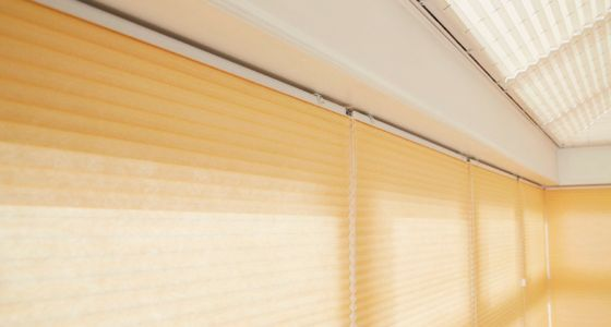 Yellow Pleated blinds in conservatory -