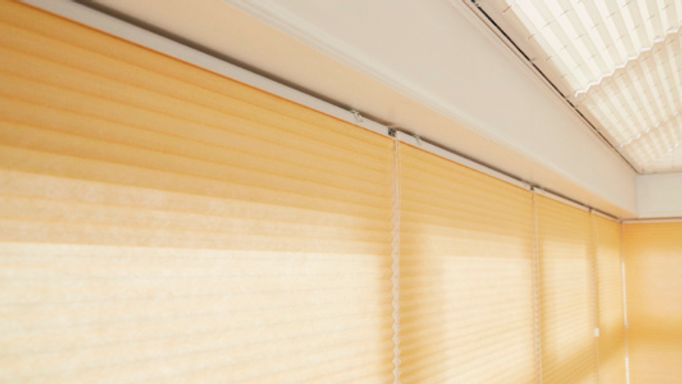 Yellow Pleated blinds in conservatory
