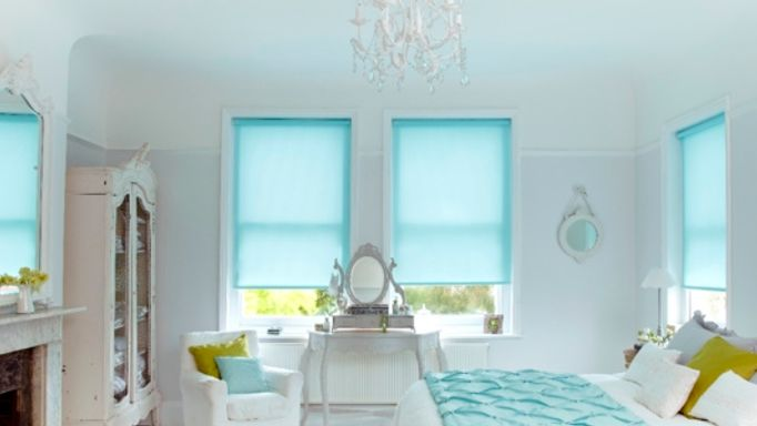 Lisbon Aqua Blue Roller blinds in the bedroom