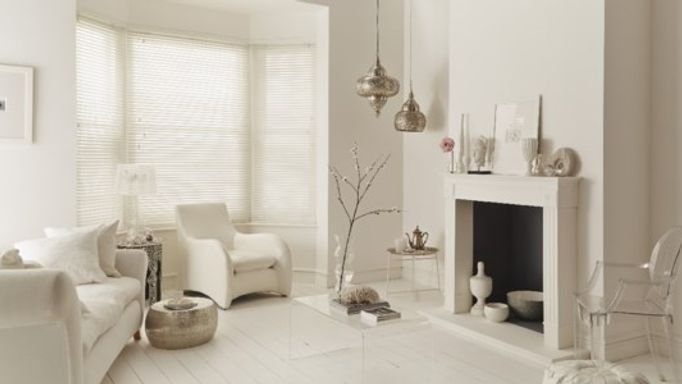 White wooden blinds in a white living room
