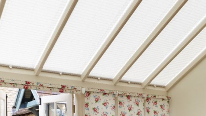 rosie posie ivory roller blinds for a conservatory roof