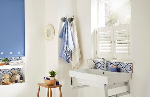 Atlantic Blue Roller blind with cafe style shutters