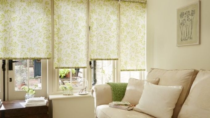 Almeria Grass Green Roller Blinds in the conservatory