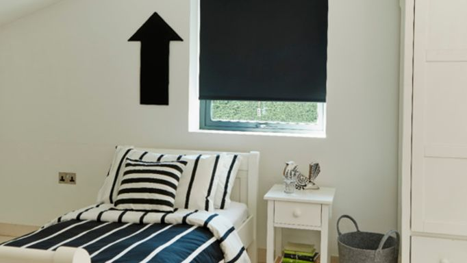 Black Roller blind in Guest bedroom