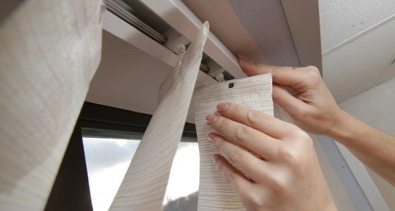 Unclip head rail to clean vertical blinds -