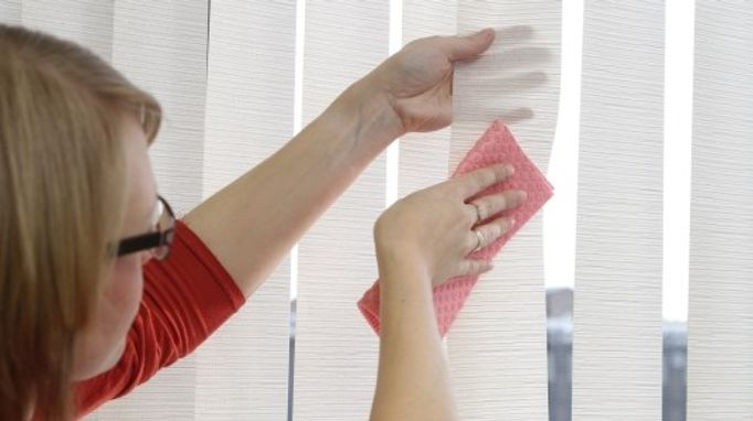 Clean vertical blinds with a cloth