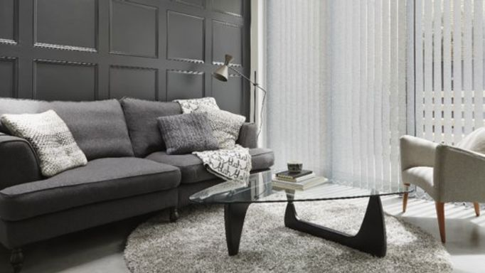 Grey Vertical blinds covering large living room window