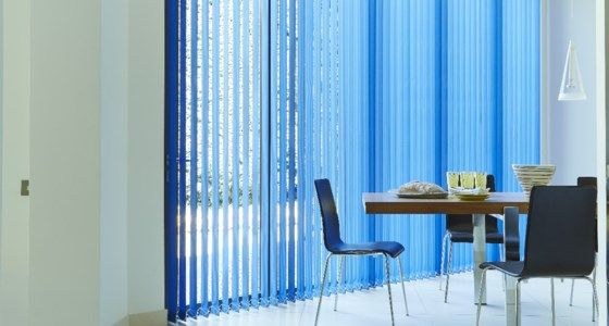 Blue Vertical blinds in dining room -