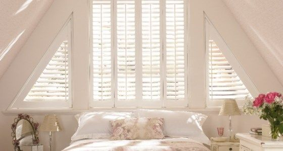 Shaped wooden shutters for unusual blinds bedroom -