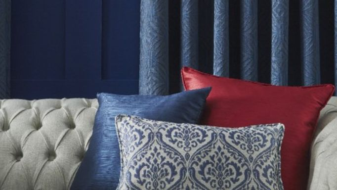 Sapphire blue Ruby red cushions and blue curtains