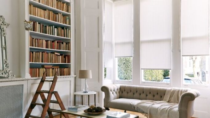 white roller blinds in study
