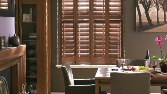 colonial style shutters in dining room